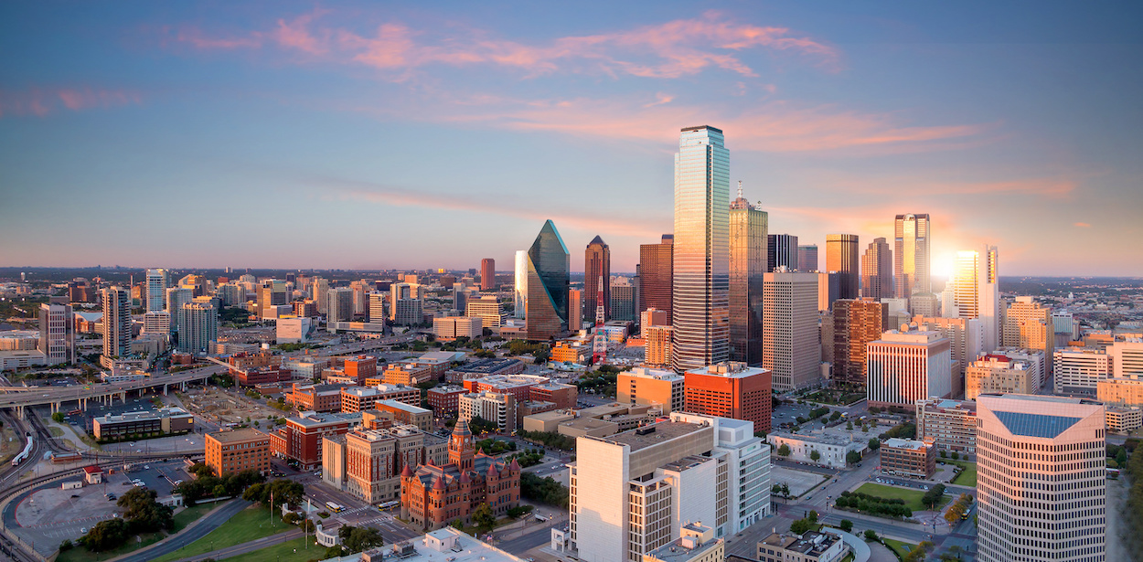 Dallas, Texas cityscape with blue sky at sunset in USA