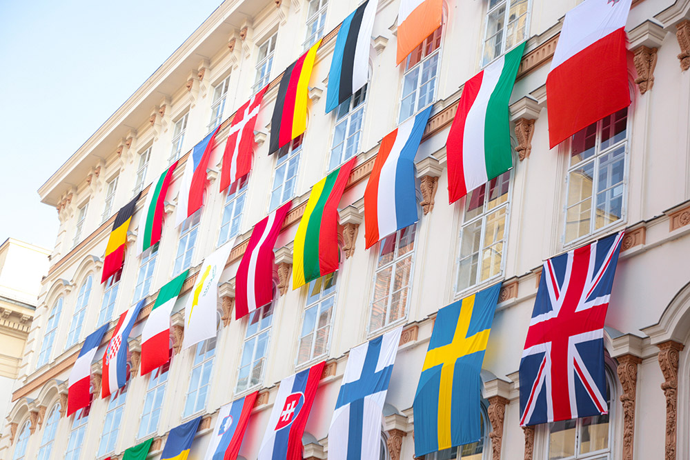 Set of European flags hanging on building with EU and UN flags in Vienna, Austria, Europe